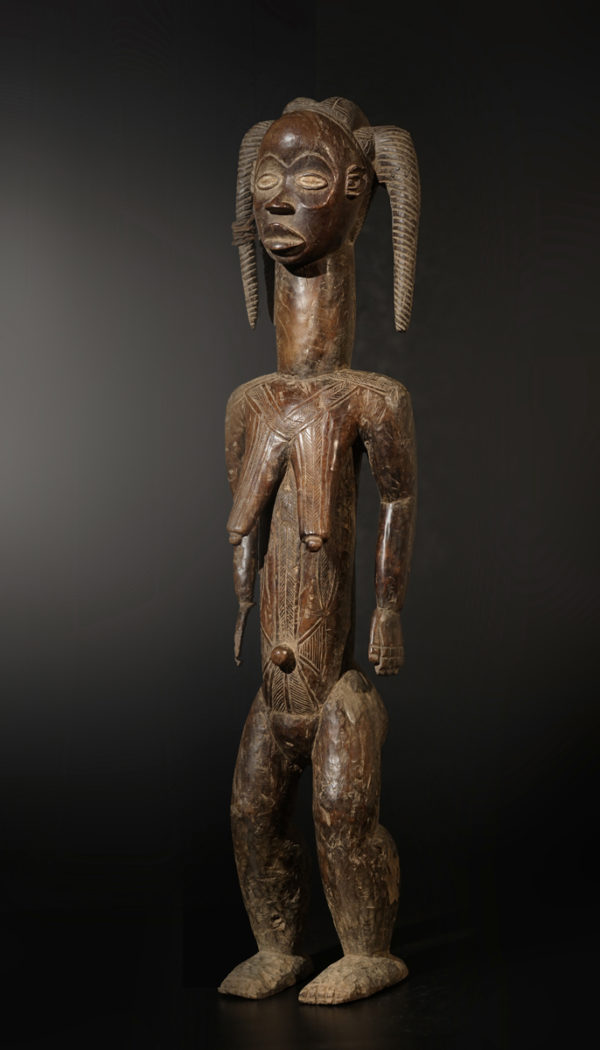 A female Bete sculpture