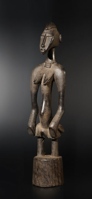 A small female Senufo Rhythm Pounder or guardian sculpture